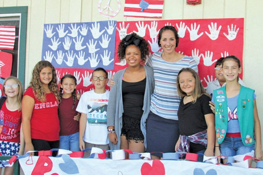 6th Grade teacher, Mrs. Anderson, with her students - veterans latest news