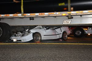 Car under big rig in Sunday night crash. photo by Rick McClure, for The Signal.