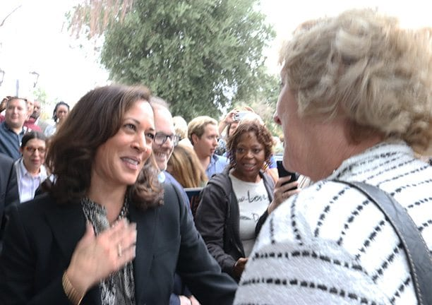 Ca. Attorney General Kamala Harris talks with a supporter outside the Democratic Party Headquarters on Lyons Avenue on Sunday. Nikolas Samuels/The Signal
