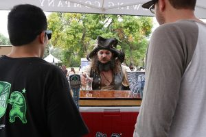 Nick Baumann gets ready for another round at the second annual SCV Brewmasters Pirate Beer Festival at Vista Valencia Golf Course on Saturday. Nikolas Samuels/The Signal