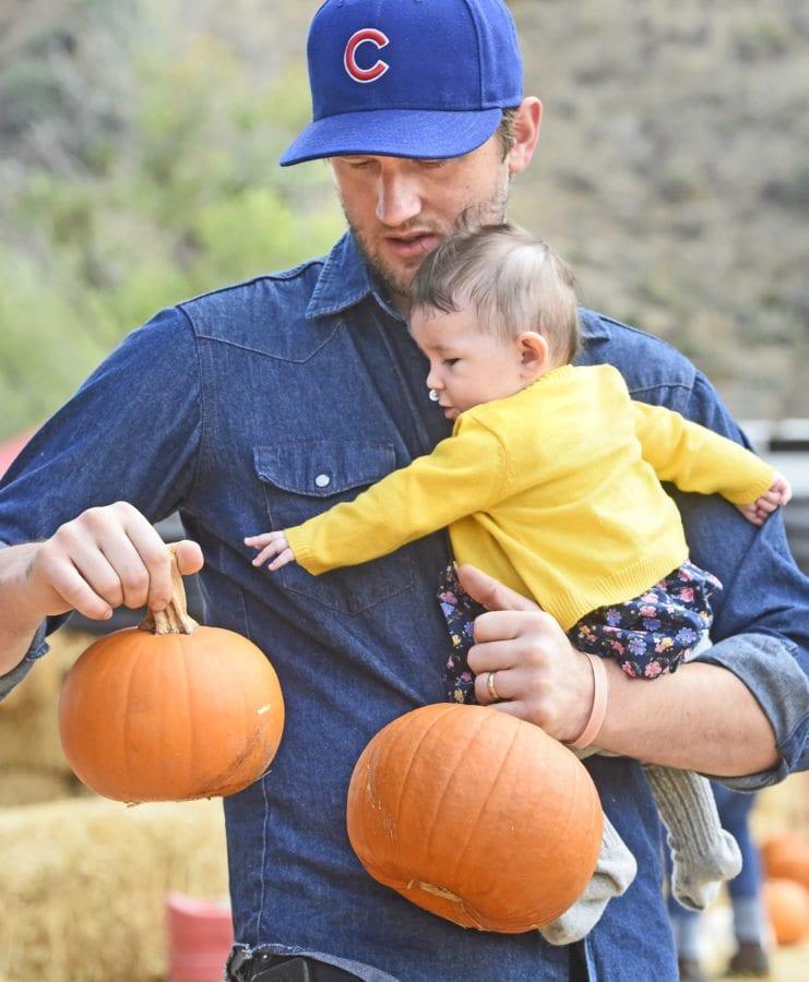 Four-month-old Snow Persky and her father Justing pick out their pumpkins at the inaugural Harvest Festival held at Gilchrist Farm in Saugus on Saturday. Dan Watson/The Signal