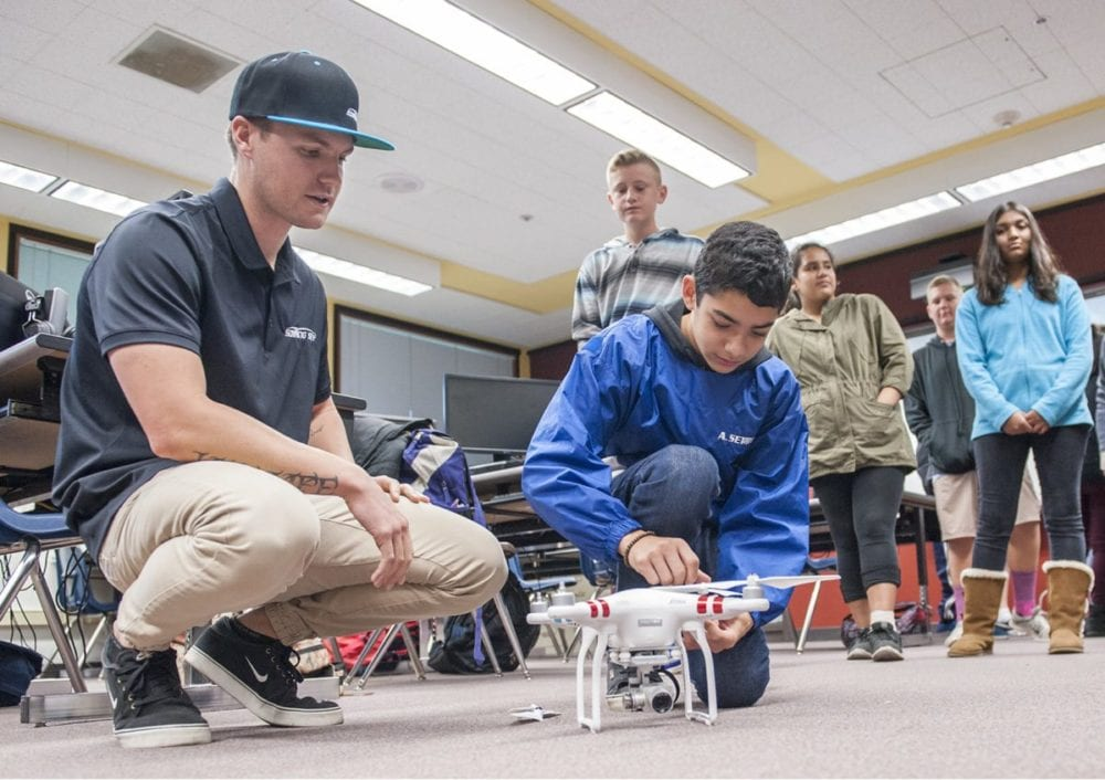 Ryan Cowell, C0-Founder of Soaring Sky, (L) assists as student Nicholas Serrano in Karen Cowell's Engineering Applications class performs a pre-flight check list to get ready for flight. Tom Cruze/For the Signal