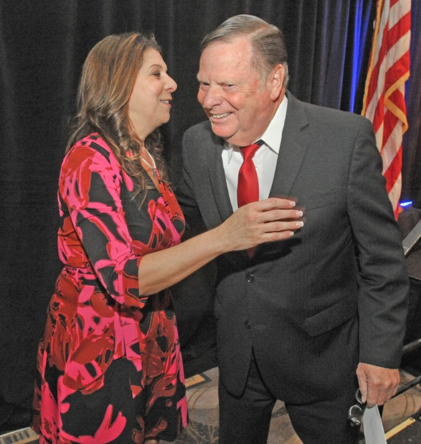 City of Santa Clarita Communications Manager Gail Morgan, left, gives Mayor Bob Kellar a hug after he told the audience she would be leaving her position and thanked her for her years of service to the City at the State of the City luncheon held at the Hyatt Regency Valencia on Thursday. Dan Watson/The Signal