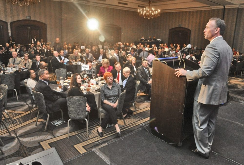 City Manager Ken Striplin, right, welcomes the attendees to State of the City luncheon held at the Hyatt Regency Valencia on Thursday. Dan Watson/The Signal