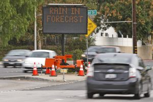 A sign on Bouquet Canyon Road near Espuella Drive warns drivers of a possible road closure following a forecast rainstorm on Friday. Katharine Lotze/Signal