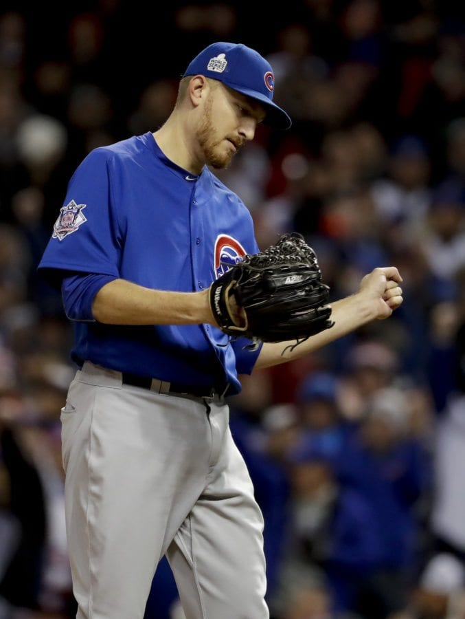 Chicago Cubs relief pitcher Mike Montgomery reacts after striking out Cleveland Indian Carlos Santana during the seventh inning of Game 2. (AP Photo/Matt Slocum)