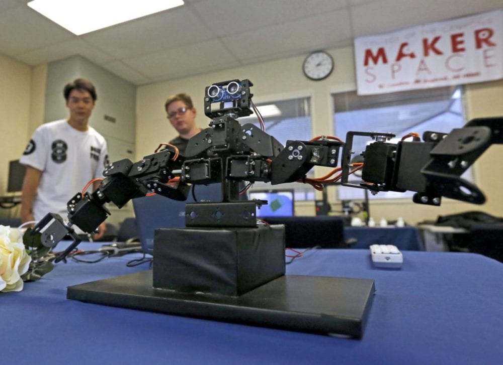 Visitors watch a mechanical robot move based on a coded script at the College of the Canyons Canyon Country Campus MakerSpace open house on Wednesday. Katharine Lotze/Signal