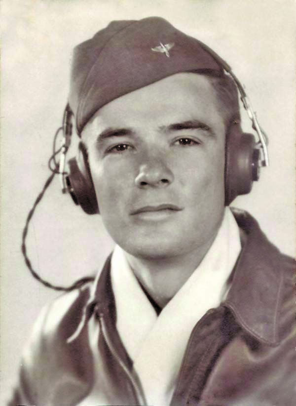 Rex Gribble, pilot trainee at Ryan Field, Arizona. Instead of wearing a flight scarf, they used a pillow case. July 1943. Courtesy photo.