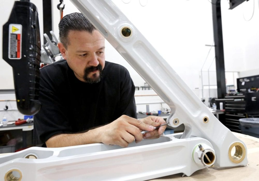 Sunvair employee Humberto Castro works on landing gear parts in the company's warehouse. Katharine Lotze/Signal