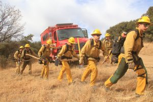 The firefighters march in to quell a fire which broke out near Fearmont