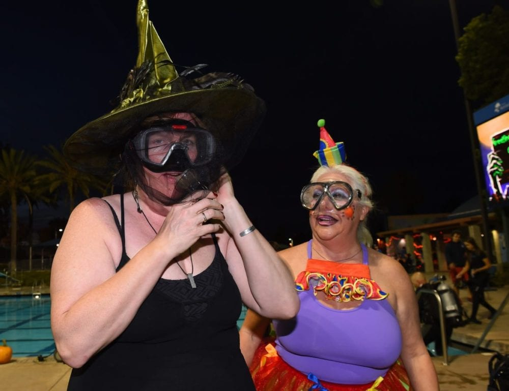 Sheryl Robinson from Simi Valley and Cathi Pearson from Santa Clarita get their scuba gear ready for underwater pumpkin carving at the Santa Clarita Aquatic Center on Saturday, Oct. 22, 2016 Photo by Jayne Kamin-Oncea/For The Signal.