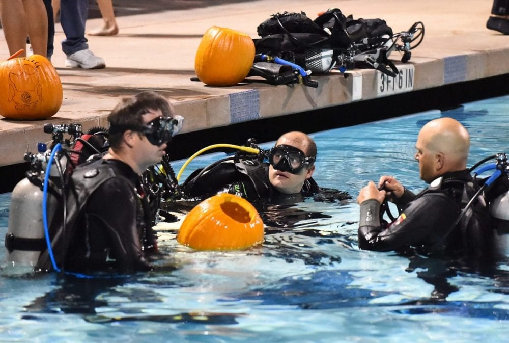 Scuba divers in the water get ready to begin underwater pumpkin carving at the Santa Clarita Aquatic Center on Saturday, Oct. 22, 2016. Photo by Jayne Kamin-Oncea/For The Signal.