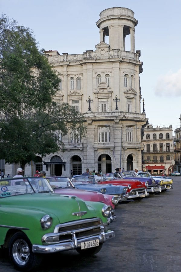 Private taxis line up on a main street in Havana. If you look like a foreigner, you'll be almost certainly asked by each driver if you need a taxi. Some will try very hard to convince you. Katharine Lotze/Signal