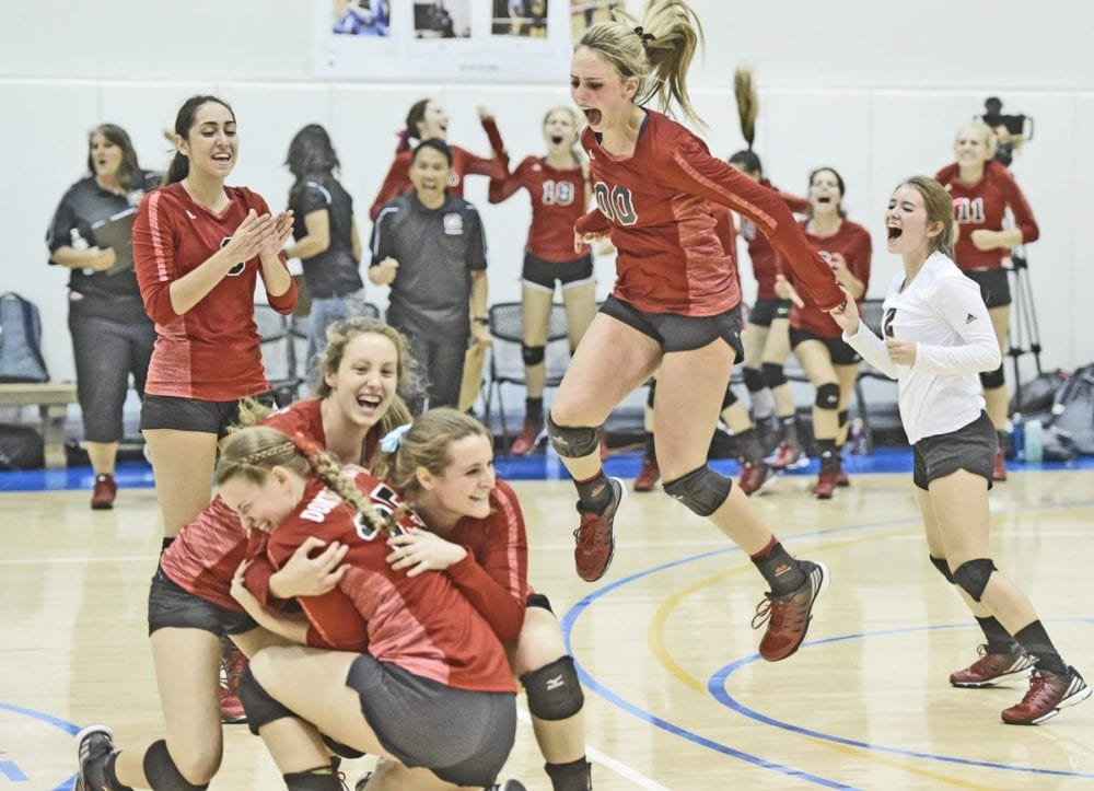 Kalona Marr (00) and her Santa Clarita Christian teammates celebrates winning the second game against Trinity Classical Academy on Thursday. Signal photo by Dan Watson for The Signal.
