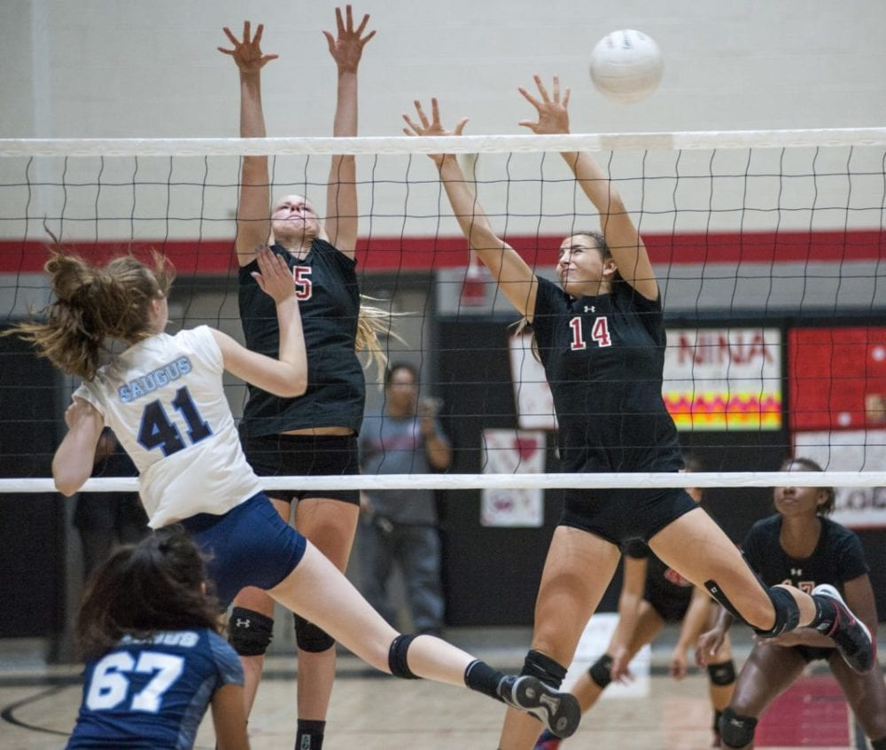 Grace Ferguson (41) of Saugus sends the ball past Madi Fay (5) and Natasha Stewart (14) of Hart. Photo by Tom Cruze for The Signal.
