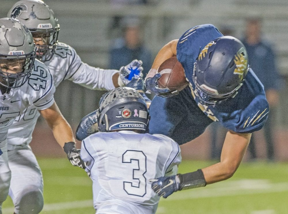 West Ranch running back Jake Rice is tackled by Saugus defensive back Gary Bojorquez (#3) in the first half at Valencia on Oct. 14.