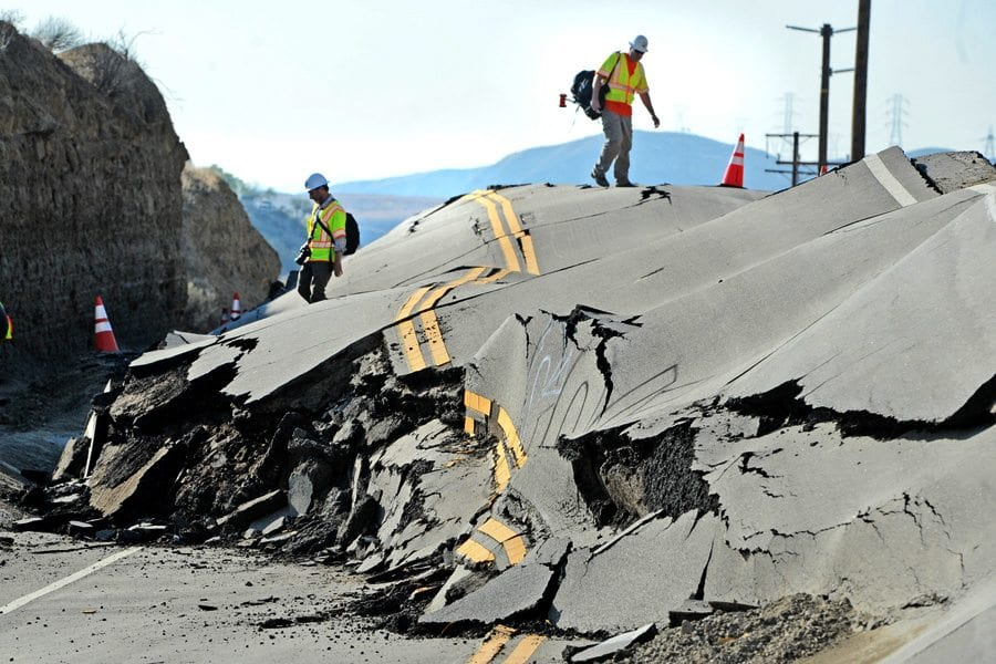 LA County Engineering Geologists climb on top of the buckled road where Vasquez Canyon Road has lifted up due to soil movement closing the road between Saugus and Canyon Country. Photo taken in November 2015 by Dan Watson, The Signal.