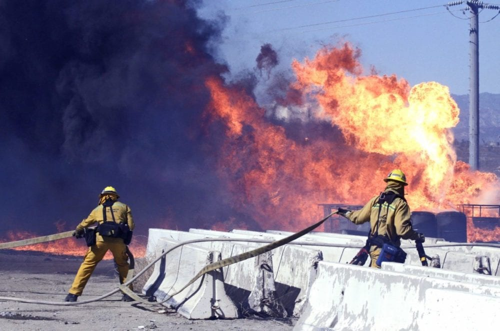 Los Angeles County fire fighters fight a fire that broke out near Sierra Highway and Via Princessa on Thursday. The fire burned through possible hazardous materials, according to officials on scene. Katharine Lotze/Signal