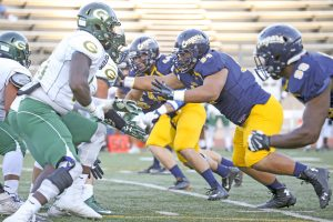 College of the Canyons defensive linemen Dorian Gerald (99) and Sione Taufahema (94) pass rush against Grossmont College on Oct. 1. John Bogna/COC Sports Information.