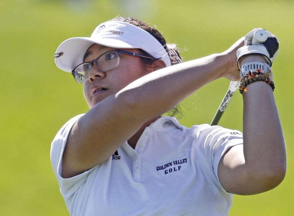 Golden Valley High golfer Justine Reblando watches her drive after teeing off at the first hole at TPC Valencia to start the final Foothill League meet on Wednesday. Katharine Lotze/Signal