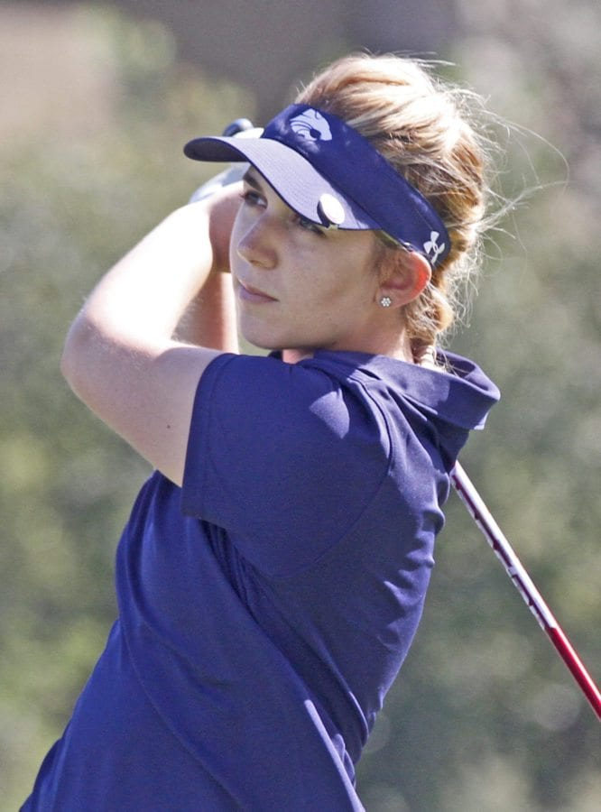 West Ranch's Ashley Mayhall tees off at the second hole. Mayhall won the day, but Bailey took the season title. Katharine Lotze/Signal