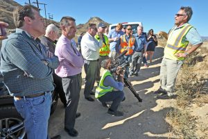 Operations Manger Hassan Amini, right, describes the soil clean up process by natural  biological agents in the soil duirng a tour to view clean-up efforts of the  Whittaker/Bermite site in Valencia on Wednesday.  Dan Watson/The Signal