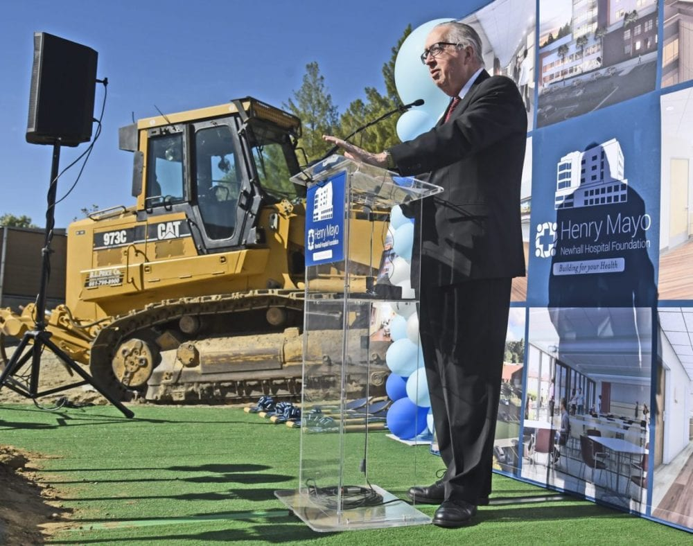 Roger Seaver, President and CEO of Henry Mayo Newhall Hospital speaks in front of a bull dozer at the Henry Mayo Newhall Hospital patient tower groundbreaking ceremony held at Henry Mayo Newhall Hospital in Valencia on Wednesday. Dan Watson / The Signal