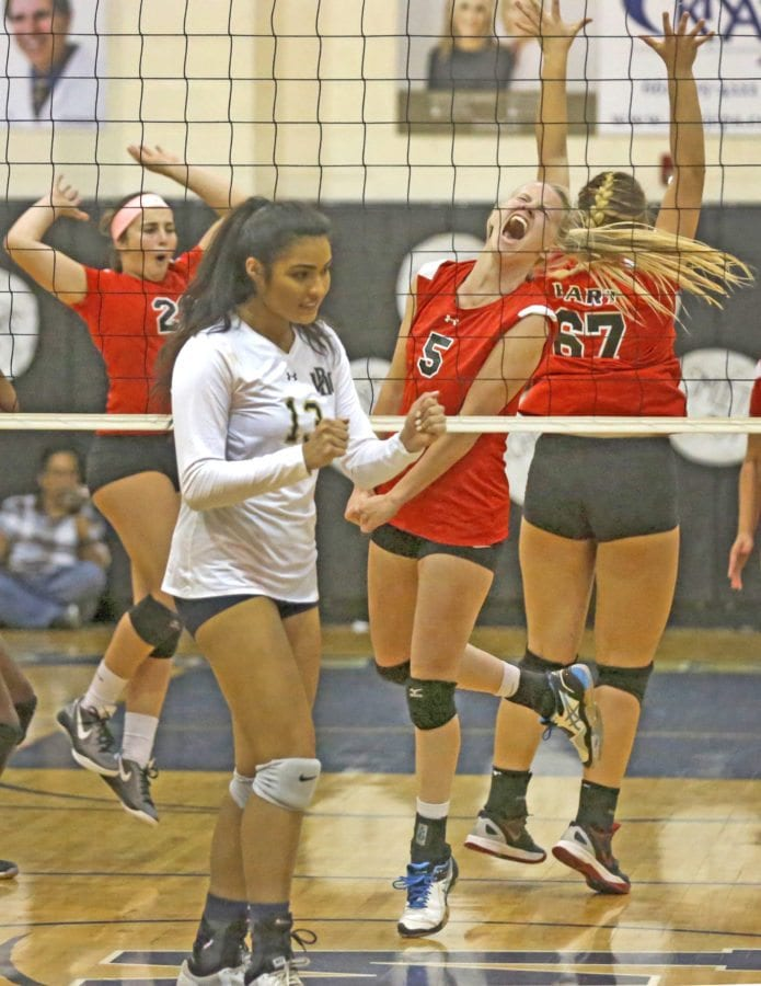 Hart's Madi Fay (5) celebrates a point over West Ranch with teammates Tuesday. Katharine Lotze/Signal