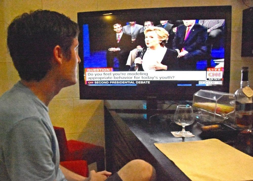 My boyfriend, Matt, watching the second presidential debate from a hotel bar in Old Havana, Cuba. Katharine Lotze/Signal