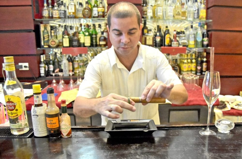 Our bartender, Andres, providing cigar service as we prepared to watch the second presidential debate at a hotel bar in Old Havana, Cuba. Katharine Lotze/Signal