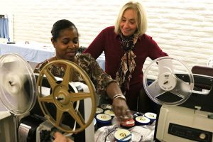 Rhonda Vigeant (right) watches over Terri Redick as she prepares her home movies for viewing at the 14th international Home Movie Day at Valencia Library at Saturday, Oct. 15, 2016. Nikolas Samuels/The Signal
