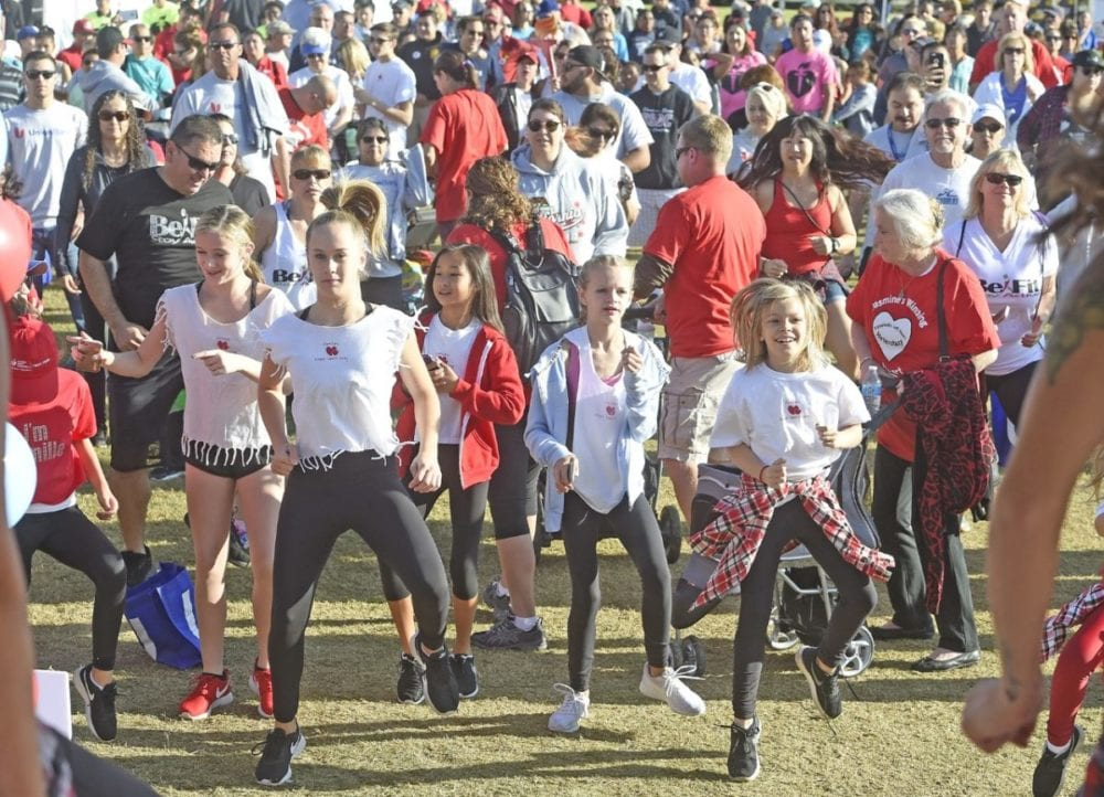 Some of the more than 1,000 attendees warm up with a Zumba class at the annual American Heart Association Heart Walk held at Bridgeport Park in Valencia on Saturday.  Dan Watson/ The Signal