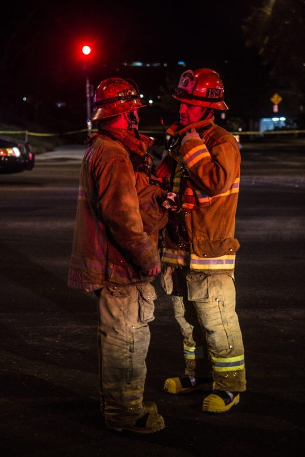 Firefighters from stations 107 and 128 formulate a plan to secure the area around a gas line break. Austin Dave/The Signal