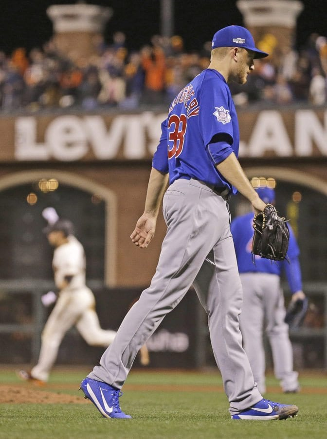 Chicago Cubs pitcher and Hart High graduate Mike Montgomery walks off the field after allowing a run-scoring double to San Francisco Giants' Joe Panik, rear left, during the 13th inning of Game 3 of the National League Division Series in San Francisco Monday.(AP Photo/Ben Margot)