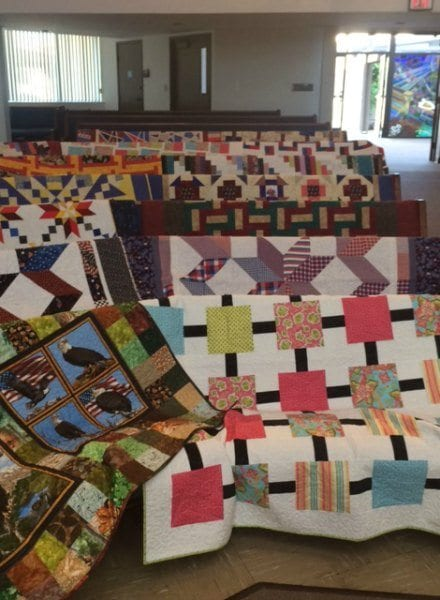 quilts arranged in the pews of the Santa Clarita United Methodist Church