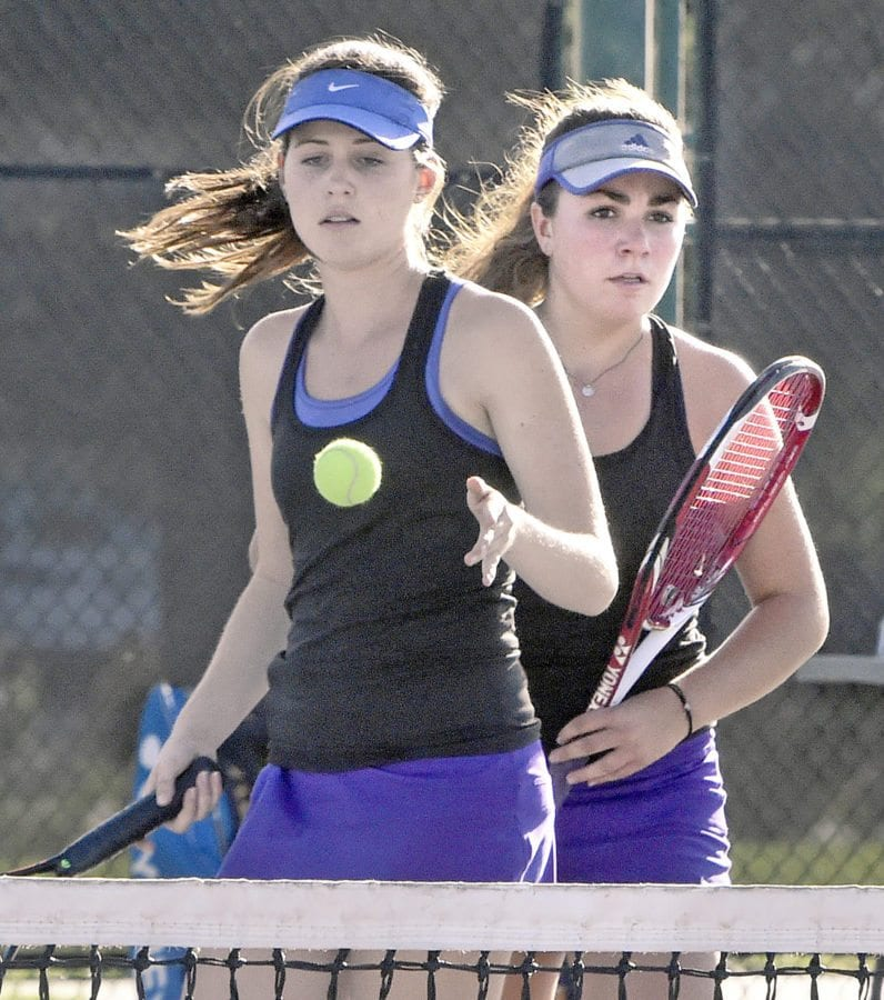Valencia Doubles team Lindsey Gollom, left, and Christina Fletcher compete against San Marino at Valencia on Monday. Signal photo by Dan Watson.