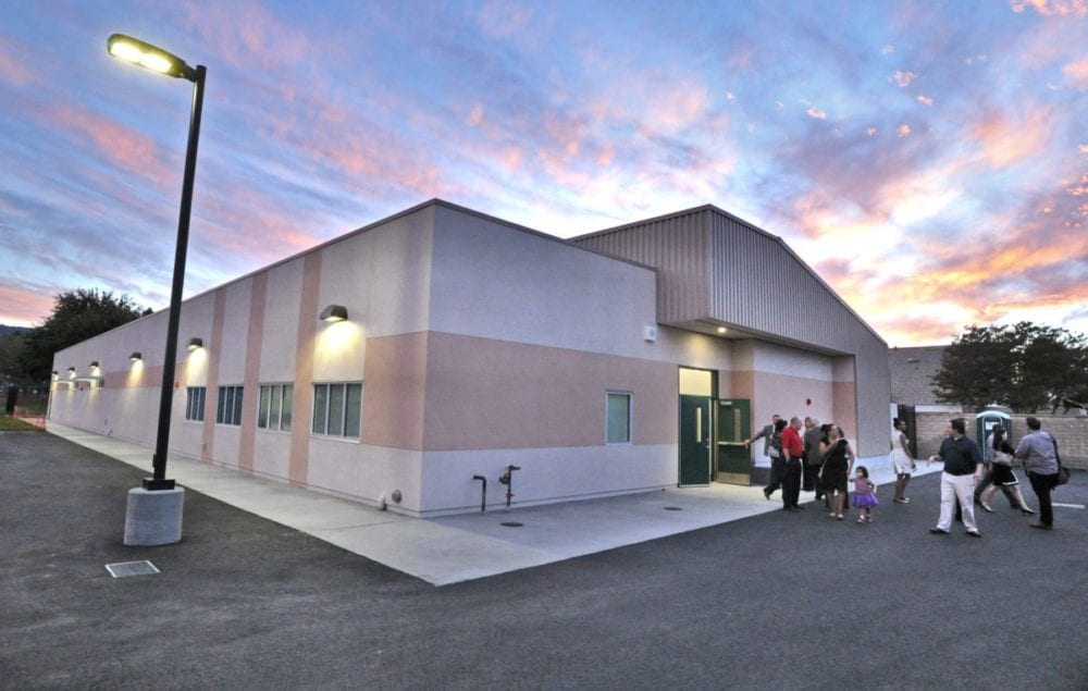 Students, parents and dignitaries tour the special education building at the school after the official ceremony for the opening of two new permanent modular buildings at Old Orchard Elementary School in Newhall on Monday. Dan Watson/The Signal