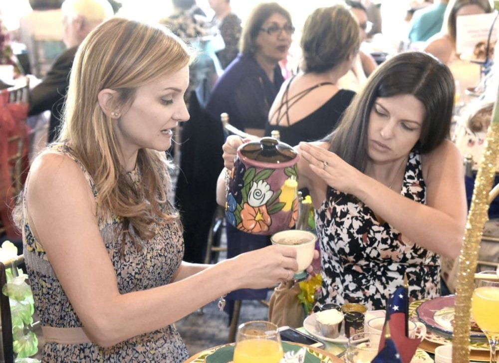 Kristen Bardin, left, and Melaina Bondy pour tea during the 13th annual Circle of Hope Afternoon Tea event held at Robinson Ranch Golf Course in Santa Clarita on Saturday.  Dan Watson/The Signal