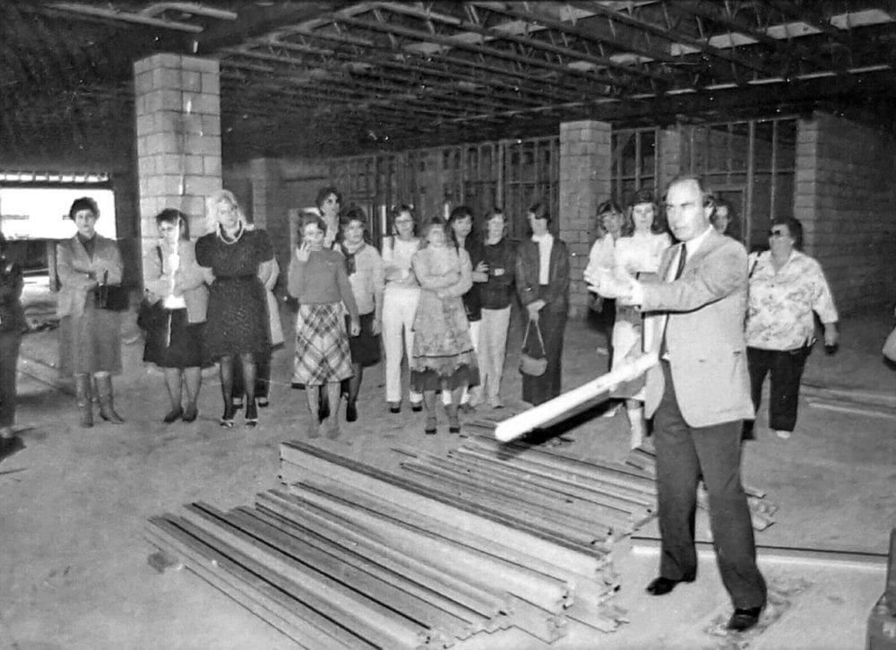 Tony Newhall, right, gives a tour of the The Signal building under construction January 22, 1986 Singal file photo