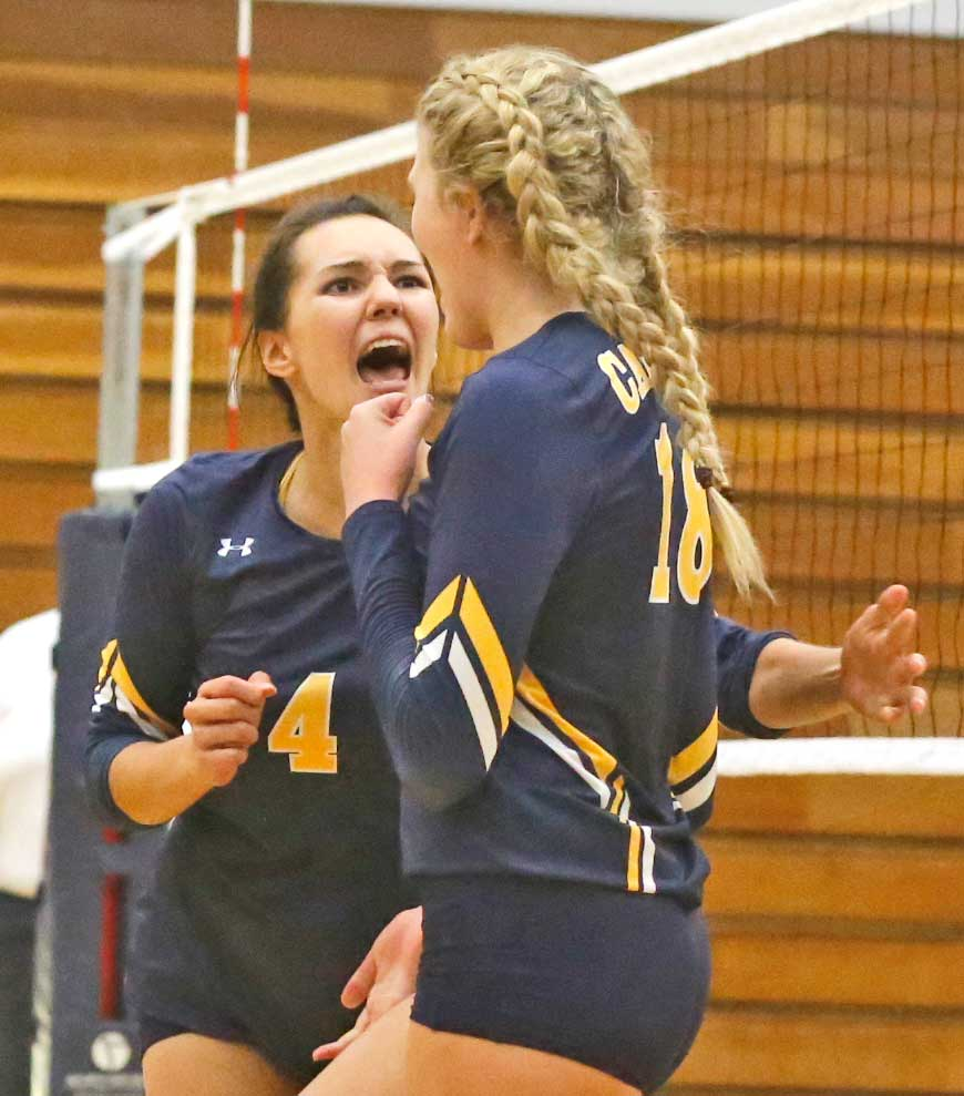 College of the Canyons' Sam Nua, left, celebrates teammate Emily Burns' successful block during a game against Pierce College at COC on Wednesday. Katharine Lotze/The Signal