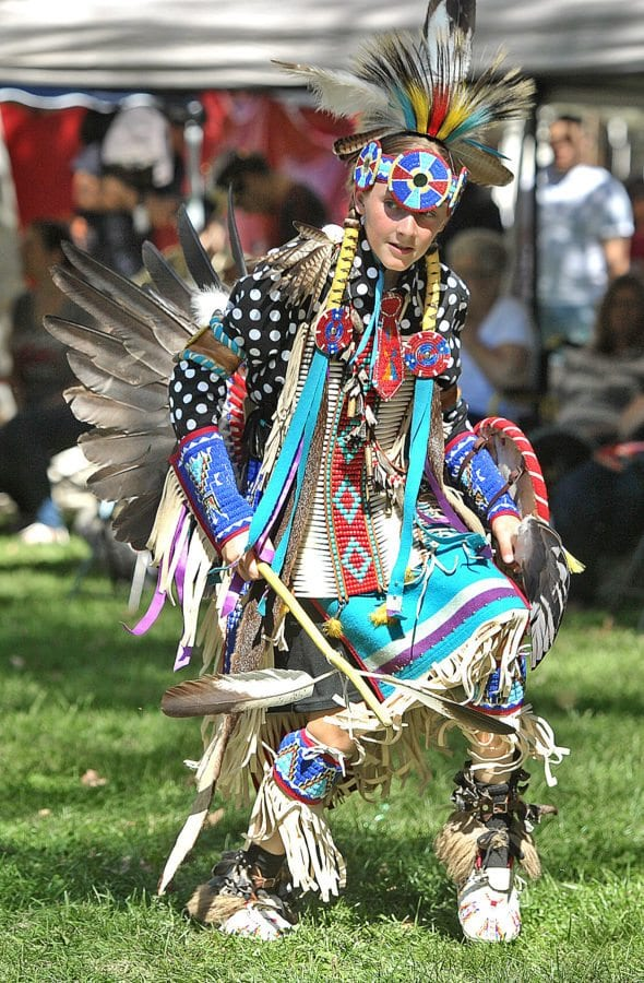 Gavin Watts, 13, dances wearing the northern traditional regalia including eagle wing bustle, bone breast plate and porcupine hair roach during the inter-tribal dance at the 23rd Annual Hart of the West PowWow & Native American Craft Fair held at William S. Hart Park in Newhall on Saturday. Dan Watson/The Signal