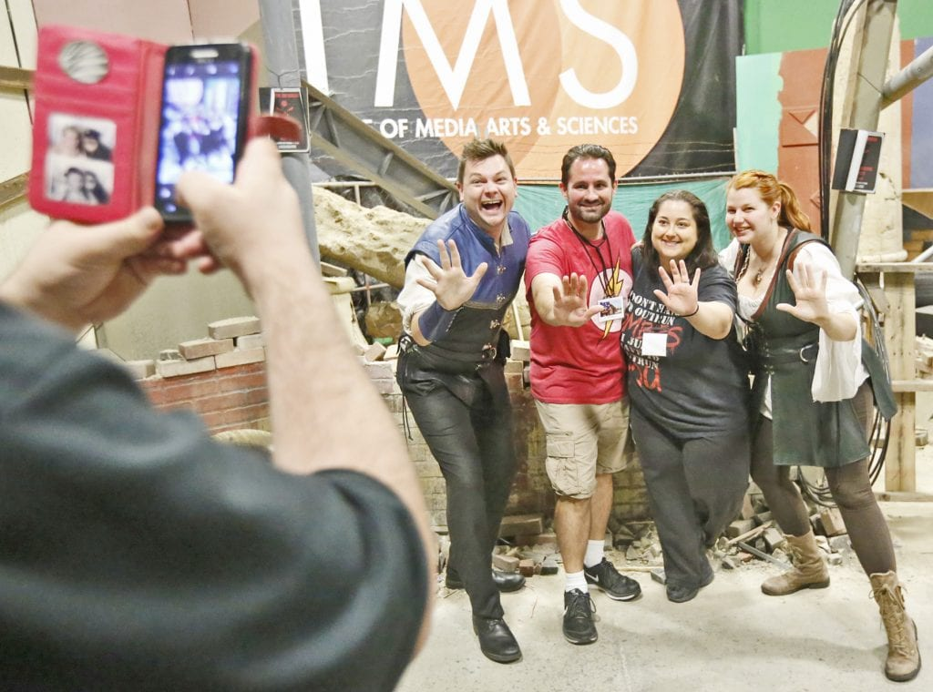 Left to right: Xander Jeanneret, Dustin Silva, Ambika Silva, and Bonnie Gordon take a photo together on the post-apocalyptic set at LIMS Motion Picture Studios in Castaic during the first day of the first-ever SCV Comic Con on Friday. Jeanneret and Gordon form the Library Bards, and performed at the first night of the convention. Katharine Lotze/Signal