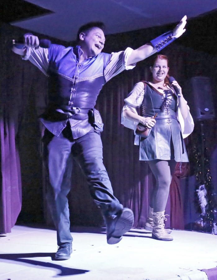 "Xander Jeanneret, left, and Bonnie Gordon, right, who form the Library Bards, perform their parody version of Meghan Trainor's ""All About That Bass"" called ""All About That Space"" during the first night of the first-ever SCV Comic Con at LIMS Motion Picture Studios in Castaic on Friday. Katharine Lotze/Signal"