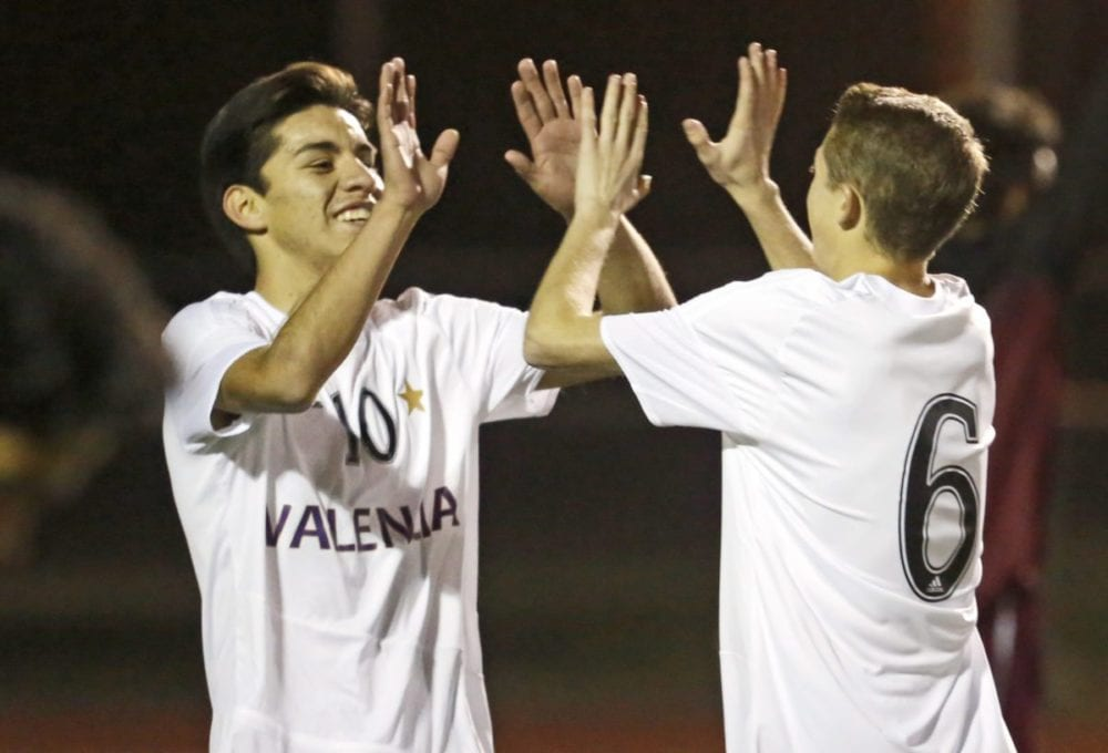 Valencia's Cesar Dominguez (10) and Tyler Traber (6) celebrate a goal during a non-conference match against Highland at Valencia High School on Wednesday. Katharine Lotze/Signal