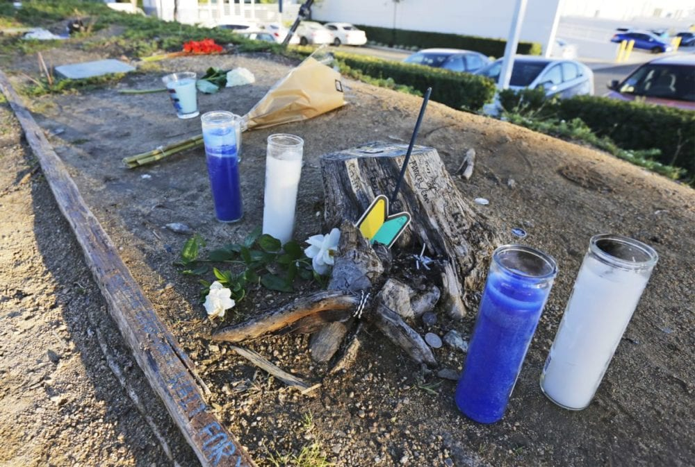 Candles, flowers and other mementos dot the side of the road on Constellation Drive on Wednesday in memorial of Paul Walker, who was killed in a car crash there three years ago. Katharine Lotze/Signal