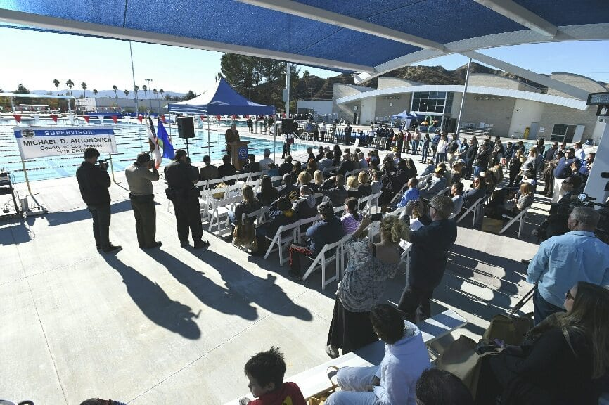 Crowds gather as Los Angeles County Supervisor Mike Antonovich speaks at a pool dedication ceremony for the Castaic Sports Complex Aquatic Center in Castaic on Wednesday. Dan Watson / The Signal