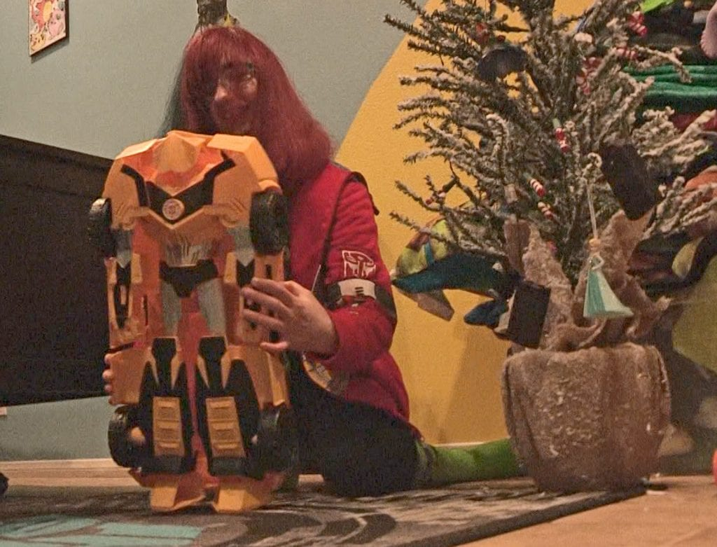 Cheyenne Hughes, 15, plays with one of her Transformers action figures inside her Canyon Country home Monday night. Austin Dave/The Signal