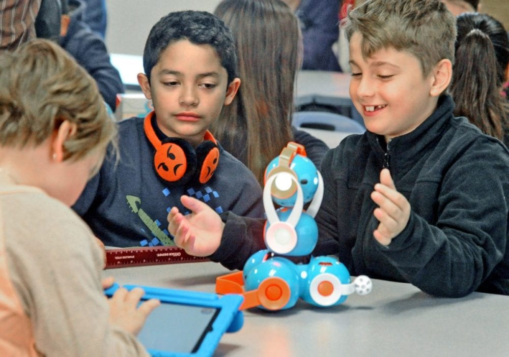 Fifth-graders Alexiz (cq) Montoya, left, and Zach Marshall configure their robot a as their team programs their robot named Cathy to perform tasks at Live Oak Elementary School in Castaic on Tuesday. Dan Watson/The Signal