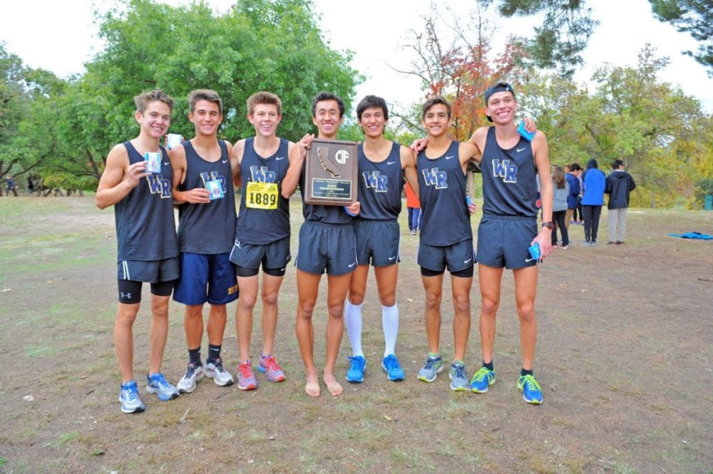 The West Ranch boys cross country team poses with its state third-place trophy in Fresno on Saturday. Photo by Leonard Coutin/For The Signal