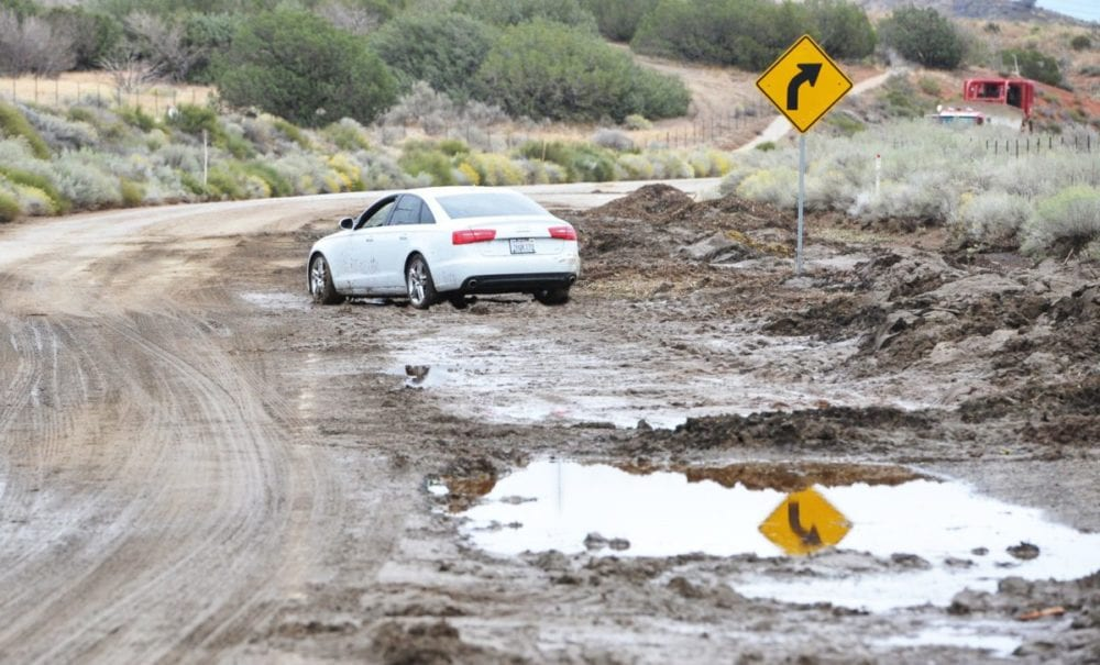 A car is stuck in the mud after heavy rainfall caused mudslides in the Lake Hughes area in October 2015. Dan Watson/Signal